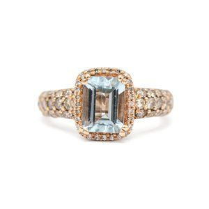 Jewelry - 14k Rose Gold Blue Topaz Halo Ring